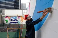 "Muralist Kyle Steed says when inspiration is lacking, he simply starts work and ""inspiration just appears.""<br><br>(David Woo/Staff Photographer)"