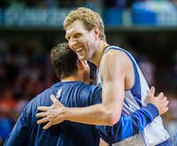 Dallas Cowboys quarterback Tony Romo hugs Dallas Mavericks forward Dirk Nowitzki before an NBA game between the Dallas Mavericks and the Denver Nuggets on Tuesday, April 11, 2017 at the American Airlines Center in Dallas. Romo was an honorary Mavericks team member. (Ashley Landis/Staff Photographer)