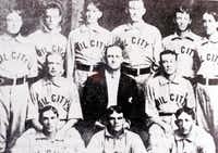 The Corsicana Oilers, spectacular 1902 champions and winners of a record 27 straight games. Standing left to right: Bellmont Method, p; Jay Justin Clarke, c; Bob White, p; Big Mike O'Connor, 1B and mgr.; George Markley, 3B; Walter Morris, ss (later Texas League president). Middle row: Frank Ripley, rf; Upton Blair, president; Curley Maloney, p-cf. Bottom row: Alec Alexander, 2B-c; Lucky Wright, p; Ike Pendleton, lf.((Corsicana Daily Sun))