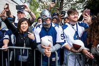Fans cheer for Dallas Cowboys players as they arrive at the stadium before an NFC divisional round playoff game against the Green Bay Packers at AT&T Stadium on Sunday, Jan. 15, 2017, in Arlington. (Smiley N. Pool/The Dallas Morning News)