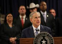 Surrounded by leadership of different law enforcement agencies, Texas Gov. Greg Abbott speaks during a new conference Monday, April 10, 2017, in Houston.  (Marie D. De Jesus /Houston Chronicle)