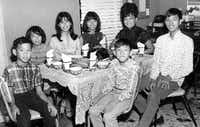A family photo of the Chu family at their first Thanksgiving dinner in the U.S. (clockwise from left) shows William, Anna, Elizabeth, Helen, Irene, Stephen and Wilson.