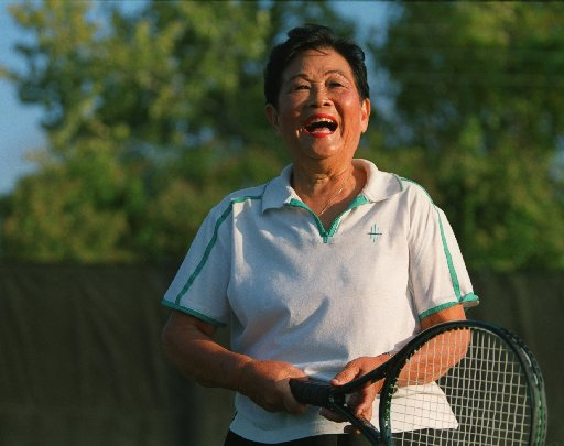 Chu took time out from tennis practice for a laugh at T Bar M Racquet Club in Dallas. She began playing tennis in Hong Kong in the 1930s. (2001 file photo)