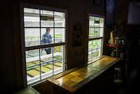 Nick Burton walks through a grow house at Paris Victory Gardens.((Smiley N. Pool/Staff Photographer))