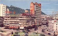 In this old photo, an arrow points out Irene and Huey Chu's food store in Hong Kong.