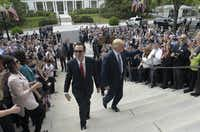 President Donald Trump and Treasury Secretary Steven Mnuchin arrive at the Treasury Department in Washington, Friday, April 21, 2017, where the president was to sign an executive order to review tax regulations set last year by his predecessor, as well as two memos to potentially reconsider major elements of the 2010 Dodd-Frank financial reforms passed in the wake of the Great Recession.(Susan Walsh/AP)