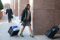 Dapheny Fain arrives at the trial in March. The man behind her is her attorney, Tom Mills. (Rose Baca/The Dallas Morning News)