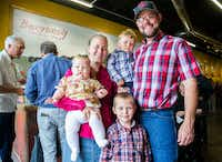 Grady and Erin Phelan and their children, Rosemary, 6 months, Benno, 2, and Ralph, 5, of Cobb Creek Farm sell their chicken at Burgundy's Local Grass Fed Meat Market. ((Ashley Landis/Staff Photographer))