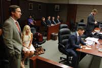 Tomi Lahren listened as her attorneys Brian Lauren (left) and Chris Simmons (center) appeared at a court hearing in Dallas on Monday. Lawyer Eli Burriss (right) represented The Blaze and Glenn Beck at the proceeding. (David Woo/Staff Photographer)