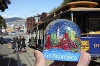 A snow globe depicts the Golden Gate Bridge in San Francisco(NYT)