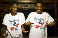 Ethiopian twins, Marcos (right) and Tamirat Bogale show off their T-shirts reading