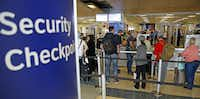 Travelers stay in line to go through the TSA security checkpoint at DFW International Airport.(Jae S. Lee/Staff Photographer)