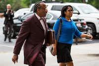 John Wiley Price walks to the federal courthouse last week with his chief of staff, Dapheny Fain. (Smiley N. Pool/The Dallas Morning News)