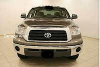 A stock photo of a tan Toyota Tundra with the area that was damaged highlighted