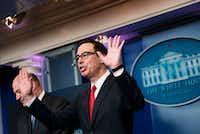 Treasury Secretary Steven Mnuchin takes questions about tax cuts with National Economic Council director Gary Cohn.(Brendan Smialowski/Agence France-Presse)