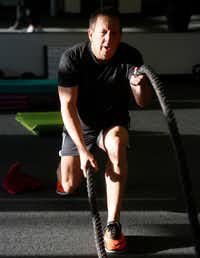 Kincel at the Battle Rope Lunges station, one of six station, during the Core Power session at Corado Fitness.((Ron Baselice/The Dallas Morning News))