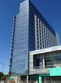 The 15-story Renaissance Hotel in Legacy West opens in June.(Steve Brown/Staff)