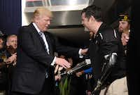 President Donald Trump greets a veteran at the Department of Veterans Affairs before giving remarks and signing an executive order on Improving Accountability and Whistleblower Protection on Thursday, April 27, 2017.(Olivier Douliery/TNS)