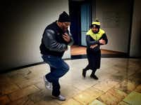 Grandmaster Caz demos some moves with B-boy Mighty Mouse during the Hush hip-hop tour of New York.((Paul Ross))