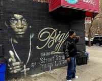 Grandmaster Caz pauses in front of a mural during the tour to reminisce about some fallen musical celebrities.((Paul Ross))