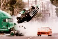 "A scene from ""The Fast and The Furious."" The mid-90s Toyota Supra is among the cars re-popularized by the street-racing film franchise.<br>(Associated Press<br>)"