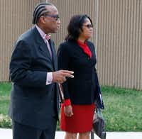 Dallas County Commissioner John Wiley Price, left, and co-defendant Dapheny Fain, wait to cross the street in downtown Dallas as the jury deliberated. (David Woo/The Dallas Morning News)