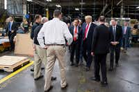 US President Donald Trump reached out to shake hands as he tours The Ames Companies, Inc., in Harrisburg, Pa., on April 29, 2017. (Jim Watson/Agence France-Presse)(JIM WATSON/AFP/Getty Images)