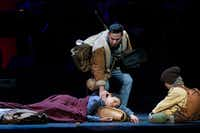 "Juan Mejia in the role of Victor, a coyote, touches the face of the dying Renata, portrayed by Cecilia Duarte, during the Fort Worth Opera's dress rehearsal of ""Cruzar la cara de la luna,"" on April 28, 2017 at Bass Performance Hall in Fort Worth, Texas. (Robert W. Hart/Special Contributor)(Special Contributor)"