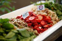 This healthy Globe Life Park salad features strawberries, quinoa, baby spinach and toasted walnuts.&nbsp;<div><br></div>(Rose Baca/Staff Photographer)