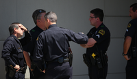 "<p><span style=""font-size: 1em; background-color: transparent;"">Interim Dallas Police Chief David Pughes, with his hand on his forehead, gathered with officers at Baylor University Medical Center.</span></p>((Andy Jacobsohn/Staff Photographer))"