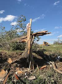 "<p><span style=""background-color: transparent; font-size: 1em;"">The chaos from the storm left this cross-like piece made from a fallen tree, two-by-fours and an electrical cord. ""That is the only reason why we are alive today,"" Scott said. ""There's no way a tornado just did that."" (Amanda Scott)</span></p>"