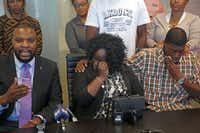 Charmaine and Odell Edwards wipe away tears as their attorney, Lee Merritt, talks Monday about the death of their son, Jordan Edwards, in a police shooting Saturday in Balch Springs.((Guy Reynolds/Staff Photographer))