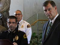 Interim Dallas Police Chief  David Pughes, left, and David Coatney, Dallas Fire and Rescue Chief, center, and Mike Rawlings, Mayor of Dallas, listen to a question from the media about the firefighter shooting on Monday, May 1, 2017, at Dallas City Hall.((Irwin Thompson/Staff Photographer))