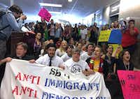 Protestors host a sit-in in the lobby of the State Insurance Building where Governor Greg Abbott's office is, on May 1, 2017, in opposition to Senate Bill 4, the Sanctuary Cities bill, in Austin, Texas.(James Barragan/staff)