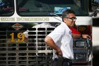 Personnel leans on Dallas Fire-Rescue engine 19 outside of the Baylor University Medical Center at Dallas emergency room after a Dallas Fire-Rescue paramedic was transported their after being shot on Monday.((Andy Jacobsohn/Staff Photographer))