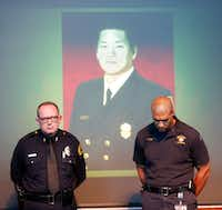 A photo of wounded firefighter-paramedic William An dominated a news conference held by Assistant Police Chief Randy Blankenbaker (left) and Dallas Fire-Rescue spokesman Jason Evans. (Jae S. Lee/Staff Photographer)