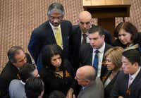 Democrats huddle on the House floor to discuss a deal to end the debate or continue the fight against a bill to ban sanctuary cities. (Ricardo B. Brazziell/<p>Austin American-Statesman</p>)