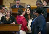 Rep. Mary Gonzalez (left), D-Socorro, consoles Rep. Diana Arevalo, D-San Antonio, shortly before the affirmative vote on the sanctuary cities bill on Thursday. (Jay Janner/Austin American-Statesman)