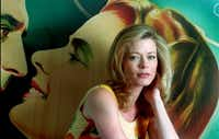 Actress Sheree J. Wilson with a film noir  poster in her North Dallas home.(Karen Stallwood)