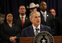 Surrounded by leadership of different law enforcement agencies, Texas Gov. Greg Abbott speaks during a new conference on April 10 in Houston. (Marie D. De Jesus/AP)