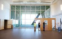 Kitchen Dog Theater staff work on set design elements at the Wyly Theater in Dallas.(Brandon Wade/Special Contributor)
