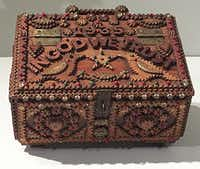 Both patriotism and religion are on display in this antique box at the Museum of International Folk Art. (Paul Ross)