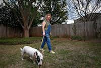 Kelli Bennett walks Simmy, a client's dog, on Wednesday, March 22, 2017, in Flower Mound, Texas. She has type-1 diabetes and attributes Obamacare to helping get her Type 1 diabetes under control . (Jae S. Lee/The Dallas Morning News)(Jae S. Lee/Staff Photographer)