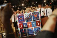 Members of the Church of Jesus Christ of Latter-day Saints take a pictures with a unity quilt designed by Faith Forward Dallas and the Oak Lawn United Methodist Church during the National Day of Prayer Luncheon.(Andy Jacobsohn/Staff Photographer)