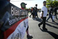 Trenton Johnson (far right), a transgender man, participates in the AIDS Walk South Dallas with other Black Trans Advocacy Coalition members near the Martin Luther King, Jr. Community Center in South Dallas on Saturday, March 25, 2017. (Rose Baca/The Dallas Morning News)