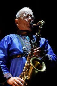 Pete Brewer provides flourishes with a tenor saxophone.(Nathan Hunsinger/Staff Photographer)