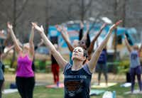 Kathy Kwart of Euless works out  during a free yoga class recently at Klyde Warren Park.<div><br></div>(Michael Ainsworth/Special Contributor)