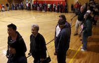 Collin County voters wait to vote in a line which stretched through the lobby and three quarters of the way around a gym for as long as 90 minutes at Christ United Methodist Church in Plano on Nov. 2, 2010.(Lara Solt/Staff Photographer)