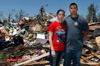 Taylor and Jonathan Beasley stand in front of their belongings in Emory on May 2. They lost their home and most of their belongings from the tornadoes on April 29. (David Woo/Staff Photographer)