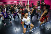 Students participate in a Twerkout with Cam class lead by Camille Thompson (right) at Power House School of Dance in Dallas. The class uses a dance style called twerking as a workout. (Ashley Landis/Staff Photographer)